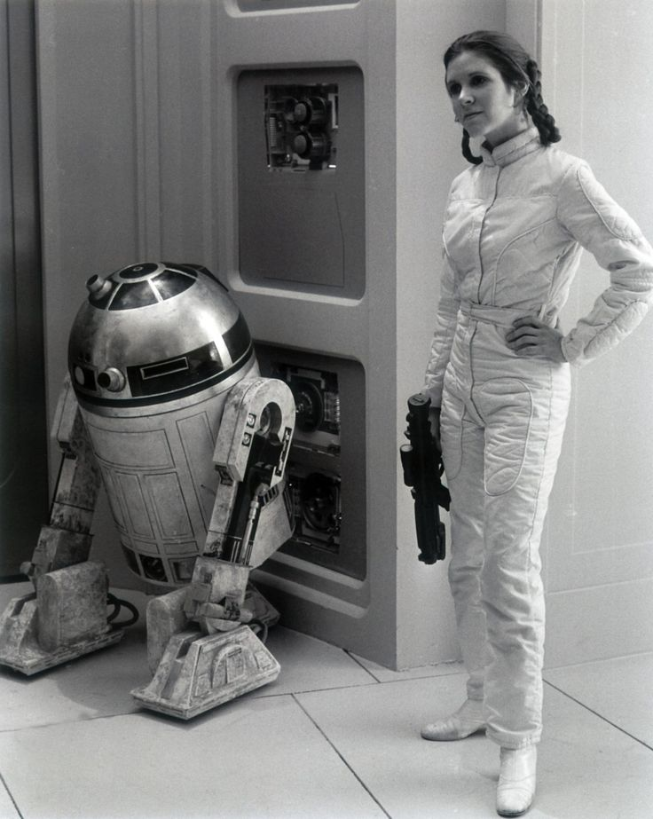 Behind the scenes...Carrie Fisher as Princess Leia with R2-D2 in EPISODE V - THE EMPIRE STRIKES BACK (1980)