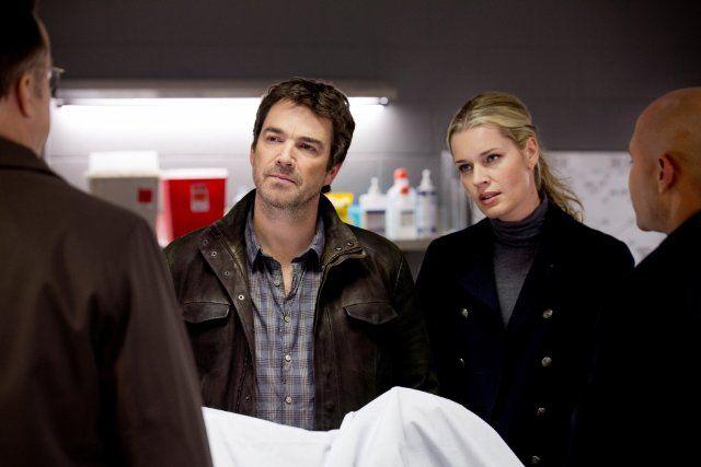 Still of Rebecca Romijn and Jon Tenney in King & Maxwell (2013)