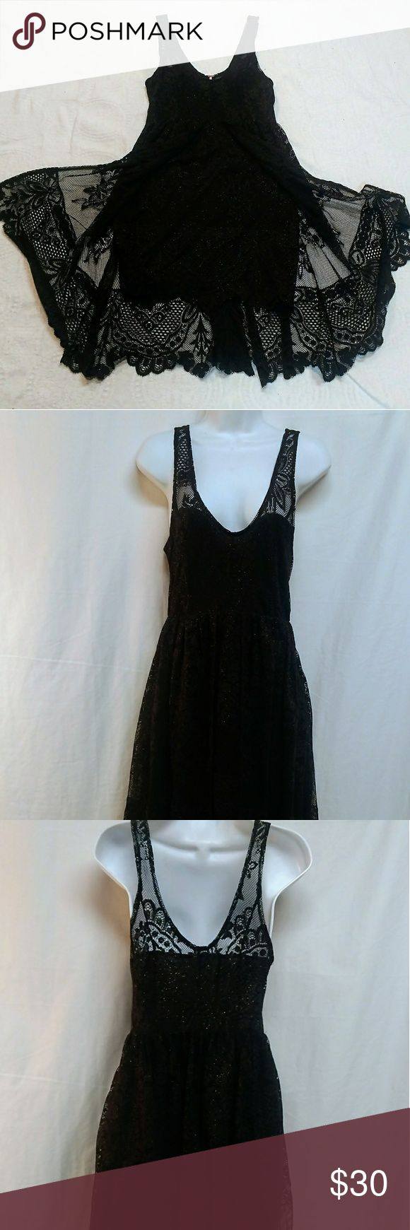 """Free People Black Lace Skater Dress. Size 6 Free People black lace skater dress with gold sparkle flecks throughout.  This dress has an attached open layer that makes this dress super fun and flirty.  The bust and skirt are lined and has a hidden side zipper.  Measurements laying flat are:  Bust 15""""  Waist 13""""  Inner skirt length is 34"""" with layers 39"""".   Ships in 1 business day.  Smoke free environment.   Thanks! Free People Dresses"""