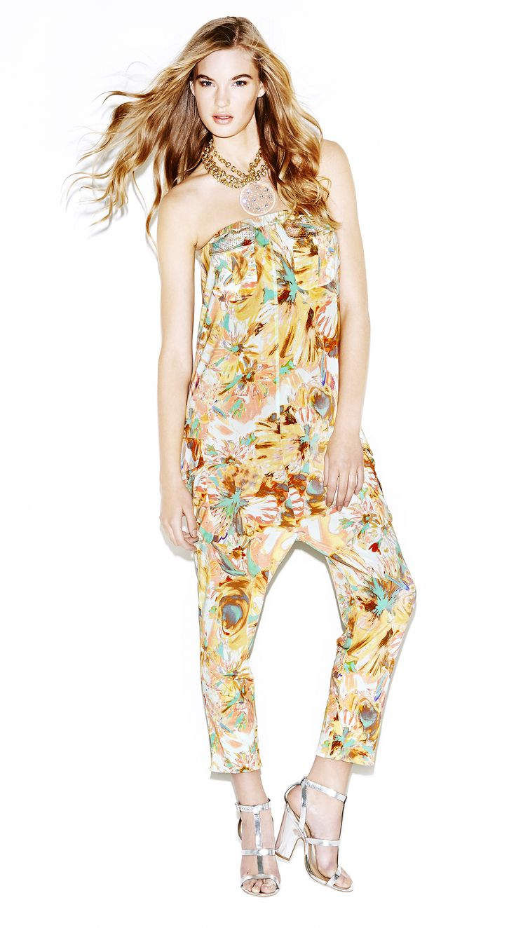 "Model wears Naughty Dog ""flower print"" bandeau jumpsuit and three lines necklace."
