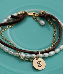 gold, leather and pearls charm bracelet