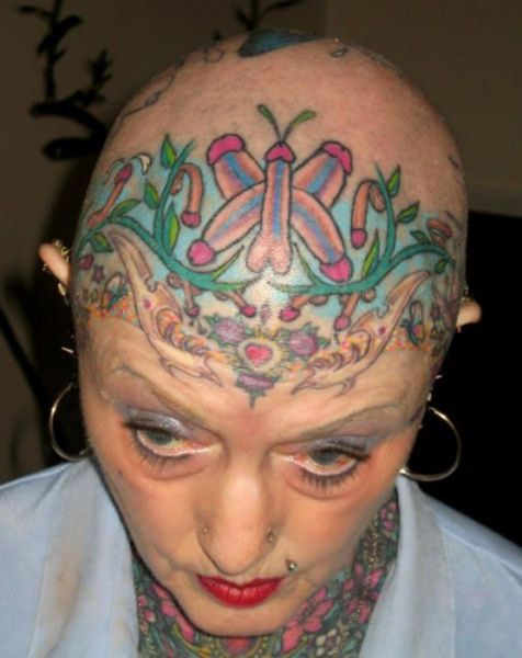 A butterfly and garden made of penises on my head!  Why didn't I think of that!  Tattoo FAIL