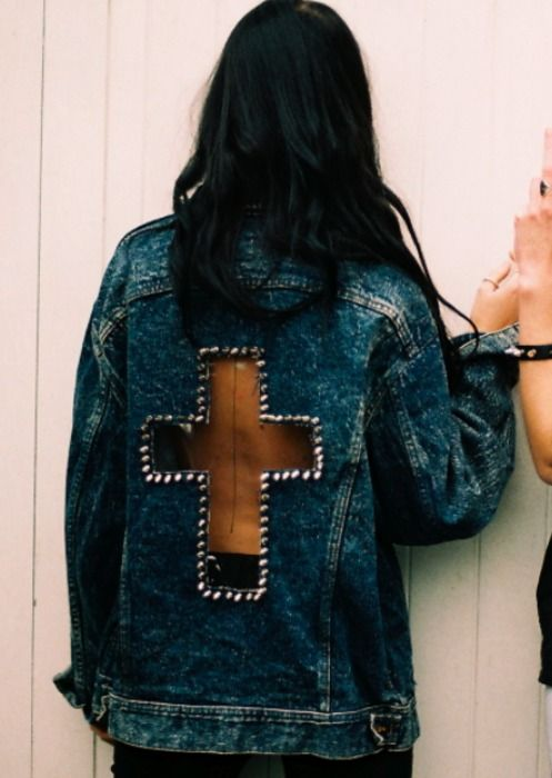Denim jacket with a nude cross in the back