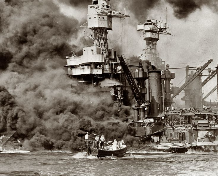 December 7, 1941. Pearl Harbor, Hawaii. Small boat rescues a seaman from the 31,800-ton USS West Virginia. Note the two men in the superstructure. The USS Tennessee is inboard.... Historical Photo Archive :: December 7, 1941