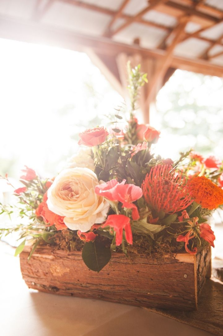 Gorgeous orange and peach centerpiece! // photo by Jennifer Baumann Photography, http://theeverylastdetail.com/2013/10/11/rustic-coral-and-aqua-wedding/