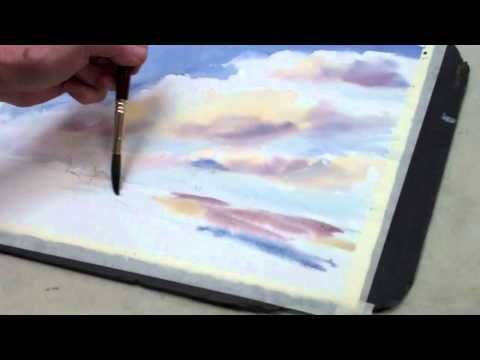 """Art League instructor Susan Herron demos a sky painting in watercolor during her class for intermediate painters, """"Creative Watercolor."""""""