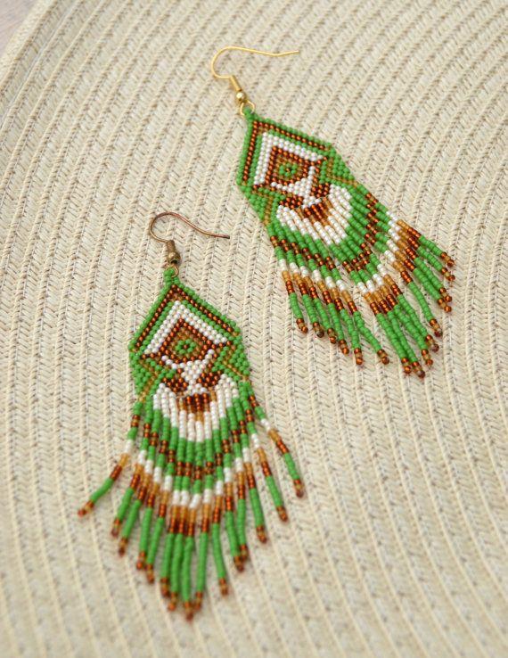 Beautiful beaded earrings with fringe. Very lightweight. Ethnic style.  Measurements: Length - 8 cm Width - 2,5 сm Materials: Metallic ear hooks Toho