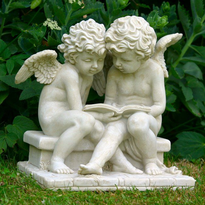 Two Cherubs On A Bench