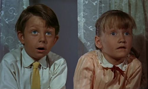 "The director of Mary Poppins didn't inform Karen Dotrice (Jane) or Matthew Garber (Michael) about some ""surprises"" that were going to show up in the movie. Karen's dumbfounded look when Mary Poppins takes out item after item from the carpet bag and her little scream when Mary Poppins gave them medicines of different colors were genuine. They also didn't tell them that Dick Van Dyke was playing Mr. Dawes Sr., and the two children were worried that the horrible old man was going to fall down."