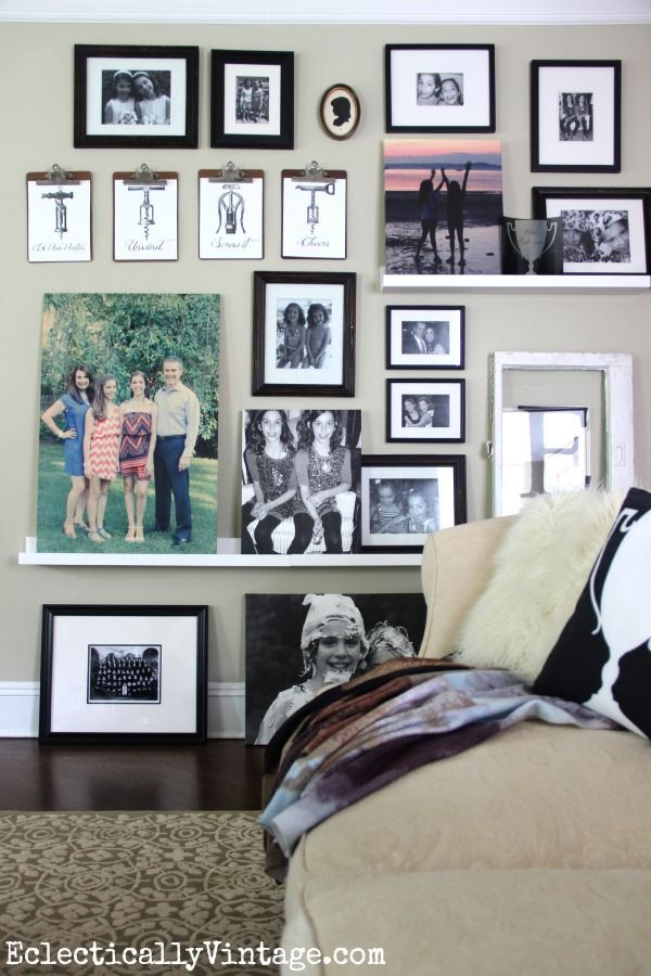 Make an eclectic floor to ceiling gallery wall with picture ledges & add black frames from Homegoods to bring the look together eclecticallyvintage.com #homegoodshappy #happybydesign #sponsored
