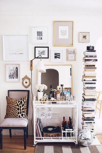 Bar cart styling. Don't forget the spaces adjacent to the bar cart…a chair, a lamp, a rug, wall accoutrements, and more.