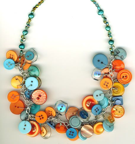 I love buttons!  I made this button necklace to wear to work when I had to work at the bead and button show. I wire wrapped all the buttons onto the chain then I added pearls and fire polish for the end.  It's orange and blue not exactly the same colors as in the scan.
