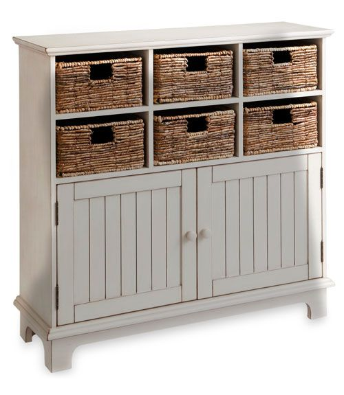 With six handwoven baskets, Pier 1's storage cabinet ($400) tidies you up.  - GoodHousekeeping.com