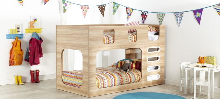 Saturn kids oak or white bunk bed with multi-coloured striped linen and décor. Available at Forty Winks.