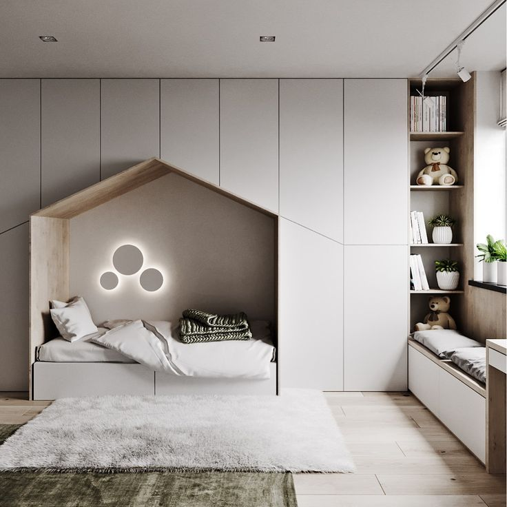 • Quarto minimalista para crianças com muito espaço de armazenamento, uma cama aconchegante e uma área de estar com janela. Projetado por @ dubrovska.studio.