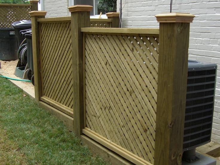 Custom wooden screen hiding unsightly ac unit