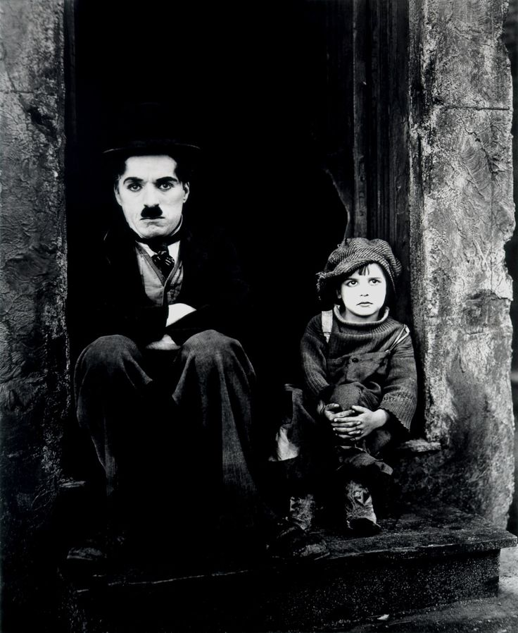The Kid is a 1921 American silent dramedy film written by, produced by, directed by and starring Charlie Chaplin, and features Jackie Coogan as his adopted son and sidekick. This was Chaplin's first full-length movie. It was a huge success, and was the second-highest grossing film in 1921, behind The Four Horsemen of the Apocalypse.
