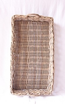 This pretty over sized wicker tray is used in my glamper.