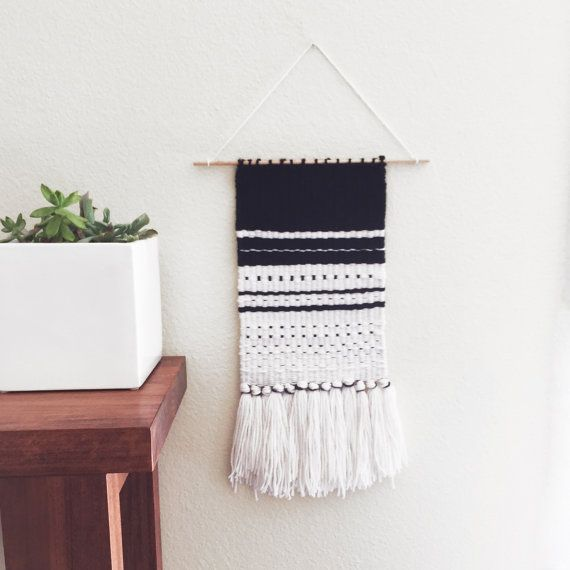 Black and white woven wall hanging    Made of cream thin-thick roving, black yarn, and monochrome colors. 8 Wide  12 Tall without Fringes  18