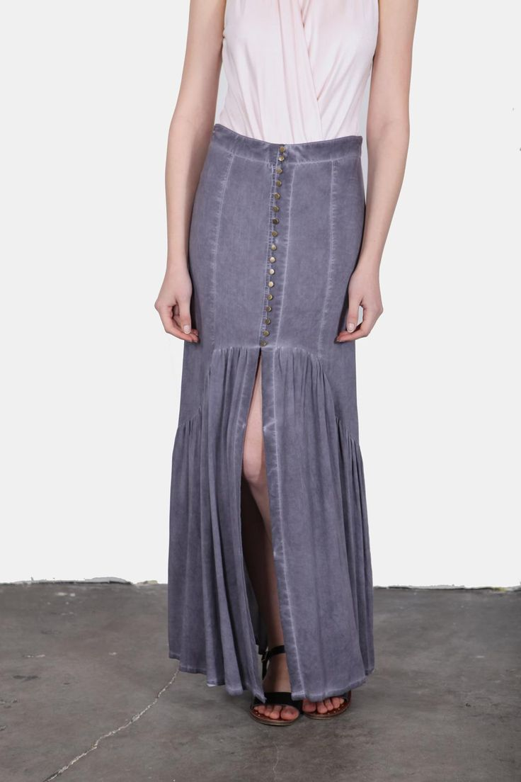 Soft washed blue maxi skirt with a ruffled hem. Deails include button down front and a high front slit.  Washed Blue Maxi-Skirt by En Creme. Clothing - Skirts - Maxi California