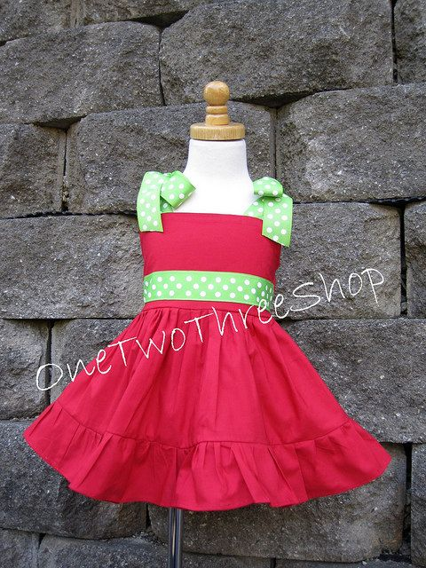 Ruffle! Could monogram the belt and do the tree design on the top part of the dress.