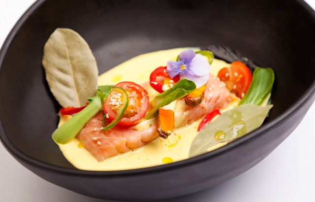 Andy Waters serves up moist, tender salmon fillets in a warming, spicy coconut sauce