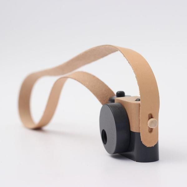 Children learn as they play and our classic wooden toy camera encourages creativity and imagination. Each is handmade in Utah from solid cherry wood with movabl