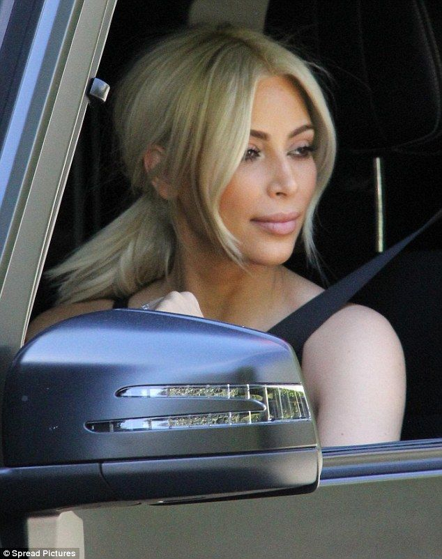 Out and about: Kim takes her husband Kanye for a spin through Beverly Hills in their Merce...