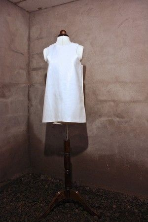 """Minimal White Faux Leather Y-Top. From """"OKKULT"""", the 2013 collection by SARA BURKHARD."""