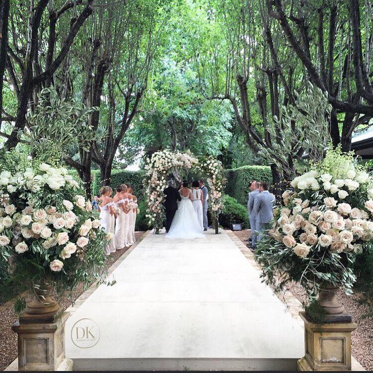 A bespoke wedding aisle framed by the beautiful avenue.