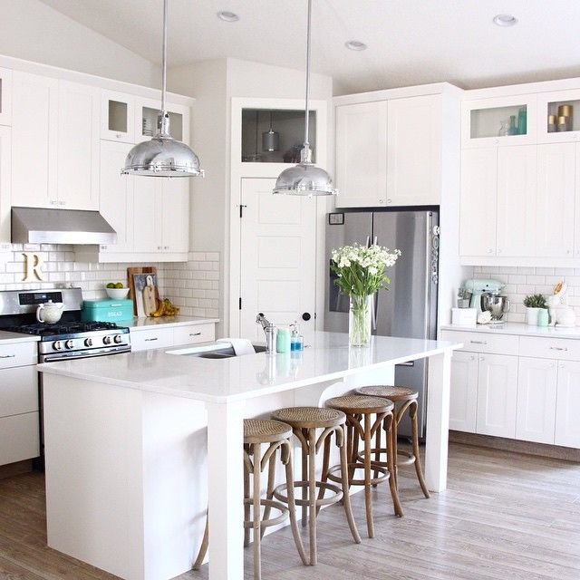 Some kitchen love our stools are from Restoration Hardware and our counter tops are Quartz. For a full source list check out our kitchen sources on the blog under decor (link in profile) #widn #cleancleanclean #whistlewhileyouwork