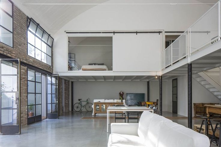 ultimate loft space; I love the amount of room you have here but its a little too white and modern for me