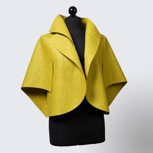 """Citrino"" Merino Wool Felt Jacket Description: A merino wool felt jacket seamlessly blending classic design sensibilities and asymmetric contemporary styling. The color and texture exude simplicity and boldness, putting the focus on the sculptural and architectural design. Open sleeves and dramatic collar. Designed, cut, and sewn by TMW. Dimensions: H:24.00 x W:24.00 x D:0.00 Inches"