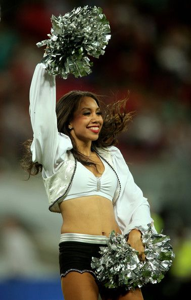 Raiderettes perform during the NFL match between the Oakland Raiders and the Miami Dolphins at Wembley Stadium on September 28, 2014 in London, England.