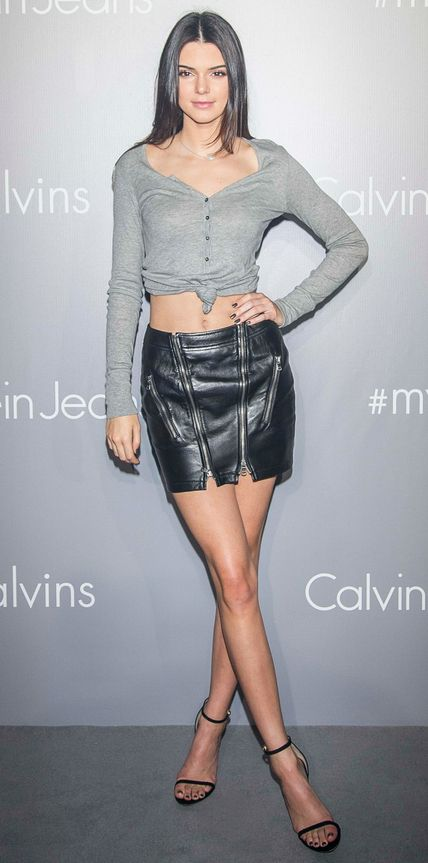 As the face of Calvin Klein Jeans, Kendall Jenner stopped by the Calvin Klein Jeans music event (clad in Calvin Klein Jeans, naturally) in Hong Kong, channeling the '90s in a knotted gray long-sleeve tee with a micro zip-up leather skirt and black delicate sandals.