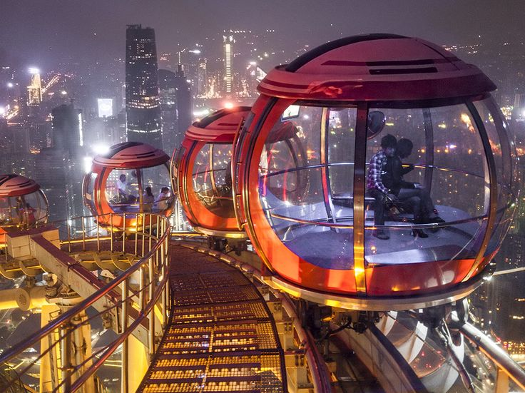 Rotating pods atop Canton Tower in Guangzhou give riders a breathtaking view of one of the world's most populous cities. The Bubble Tram is sometimes referred to as the world's highest Ferris wheel, though the track is horizontal. The cars circle the top of the tower, 1,493 feet high. Photograph by Paul Langrock, Zenit/laif/Redux, August 23, 2014