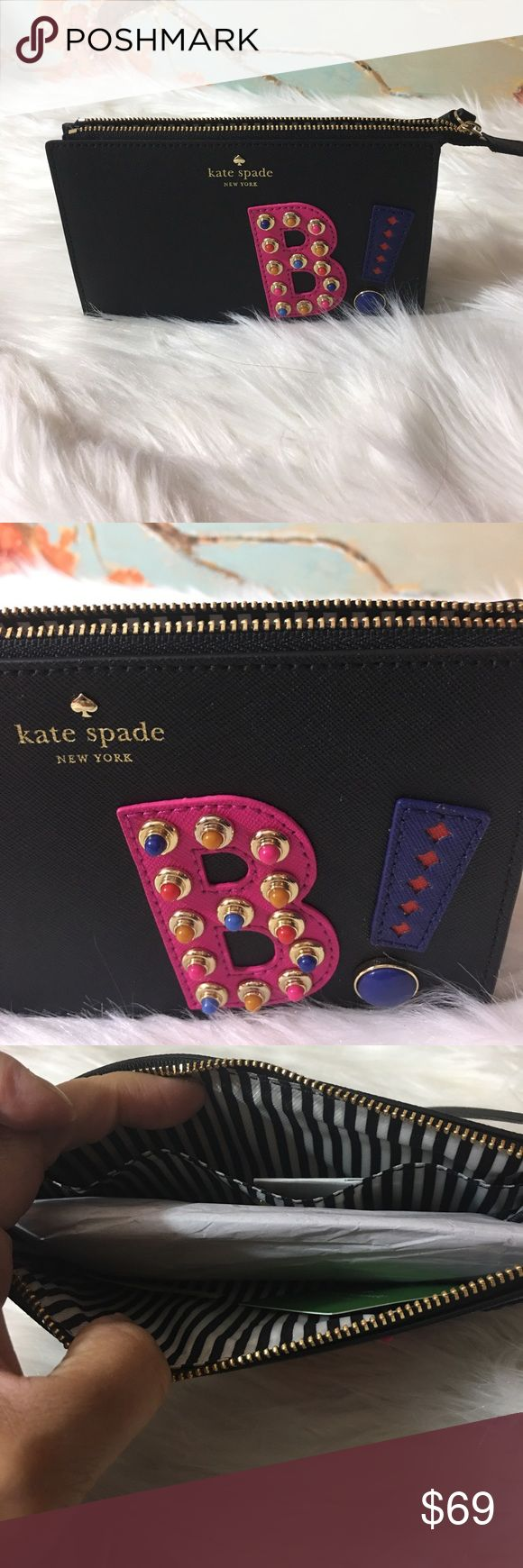 """Kate Spade Hartly Lane Clutch Brand new kate spade new york crosshatched leather wristlet. Embellished """"B!"""" text on front. Golden hardware. Zip top closure; wristlet pull strap, 6"""" drop. Foiled logo and spade stud. Interior, striped twill lining; one slip pocket. 5""""H x 7""""W x 1""""D. kate spade Bags Mini Bags"""