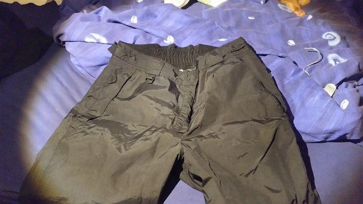 Pantalon de ski femme de marque Corverace, noir, taille 46-48 avec poches latérales zippées.