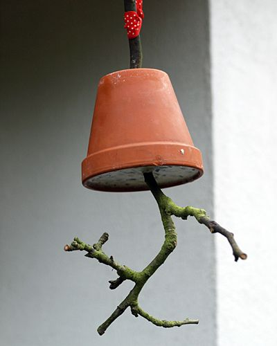 Clever diy natural bird feeder - twig, flowerpot and suet. Going to try this!