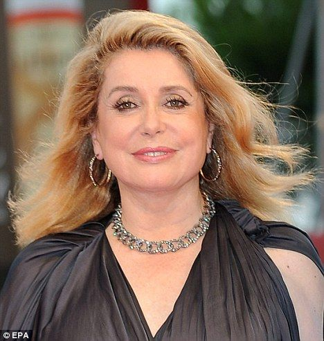 Dazzling: Catherine Deneuve looked years younger than 66 as she arrived on the red carpet at the premiere of Potiche in Venice