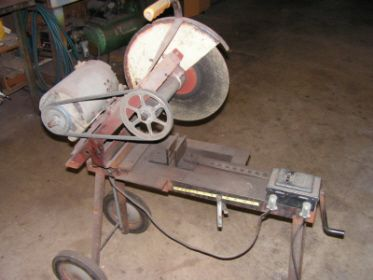 1/2 HP Chop Saw by HUH? -- Homemade chop saw fabricated from scrap and powered through a belt and pulley by a 1/2 horsepower motor. http://www.homemadetools.net/homemade-12-hp-chop-saw