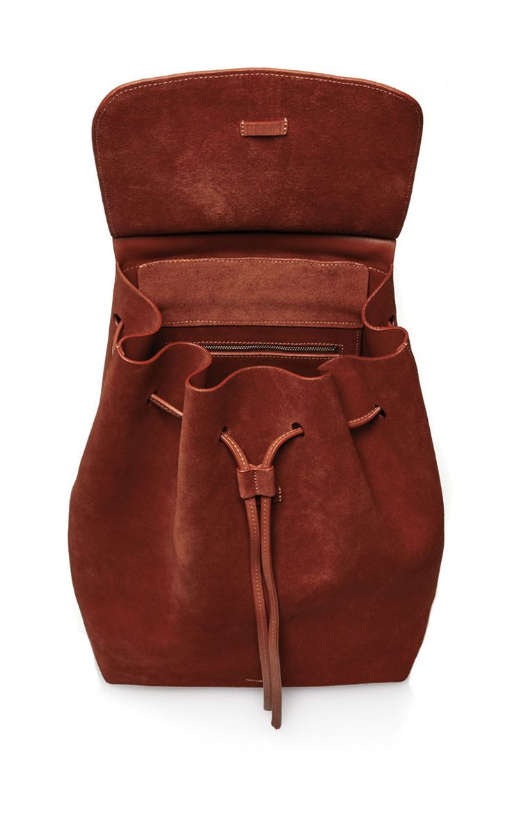 Mansur Gavriel Drawstring Backpack $895 This Mansur Gavriel backpack is rendered in suede and features a raw interior, fold over flap and adjustable shoulder straps. Product Details Composition: Suede Raw interior Fold over flap Tie closure Adjustable shoulder straps Made in Italy Product Code 532636