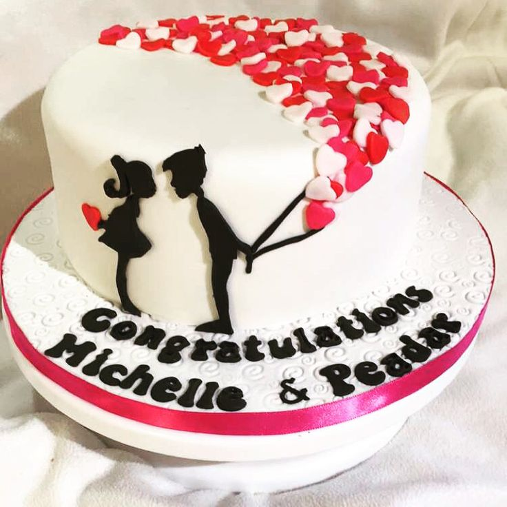Engagement cake with couple silhouette and heart balloons. – Rezepte