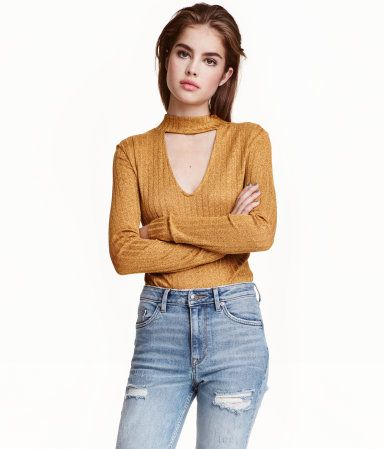 Mustard yellow. Mock turtleneck sweater in a fine rib knit with a V-neck and long sleeves.