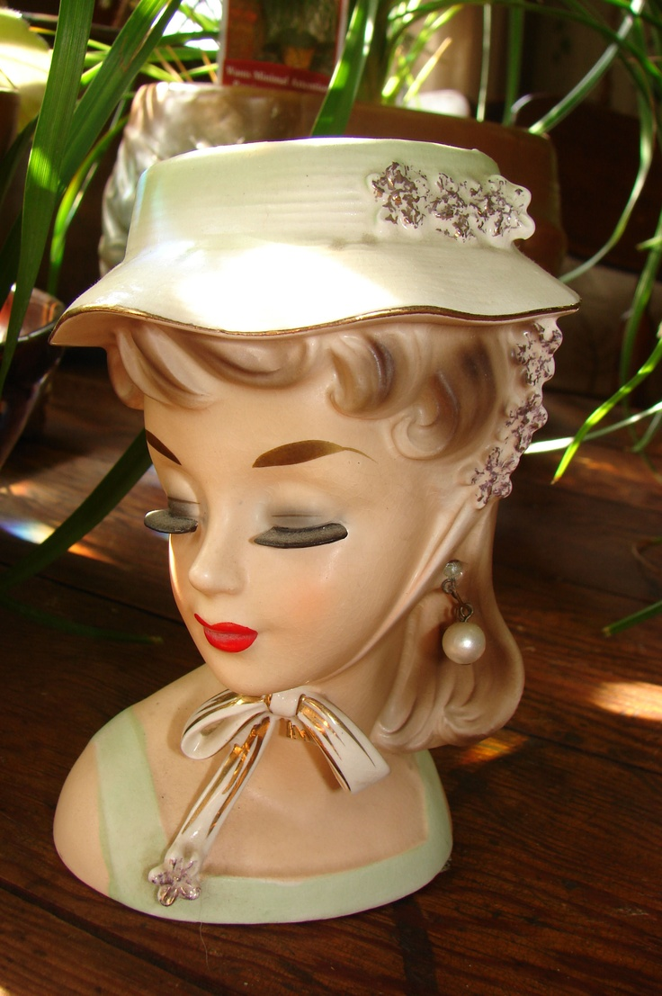 stunning head vase - sold. Not my favorite, but she's kind of cute.