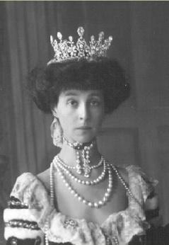 Consuelo Vanderbilt, Duchess of Marlborough, dressed in court attire and wearing the Duchess of Malborough Tiara.