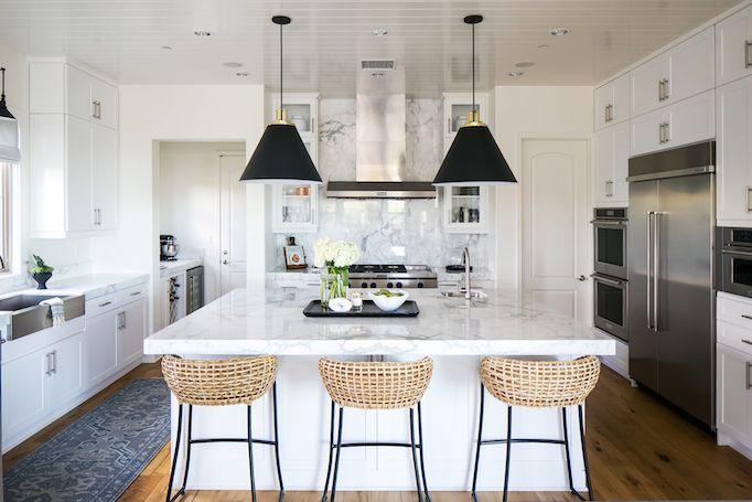 Becki Owens Estillo Project Statuary marble backsplash & counter, warm white cabinetry, pendants, organic textures, shiplap ceiling