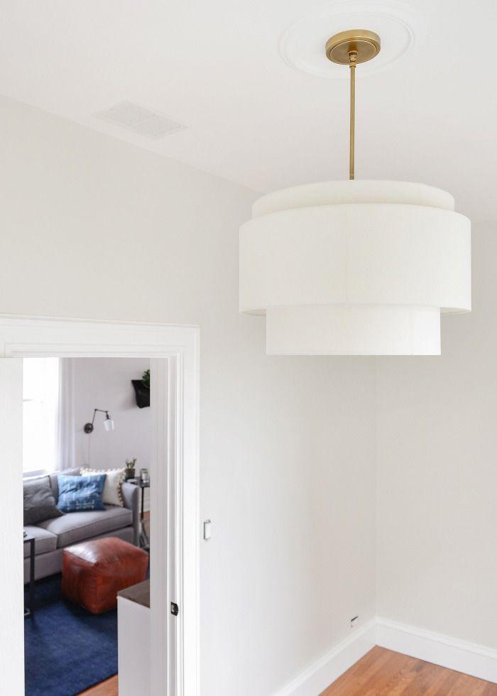 Tiered pendant. Drum pendant. Tiered drum pendant. White pendant. Linen shade. Adjustable lighting. Statement lighting. White room. Sophisticated style. Portland made lighting. Rejuvenation lighting.