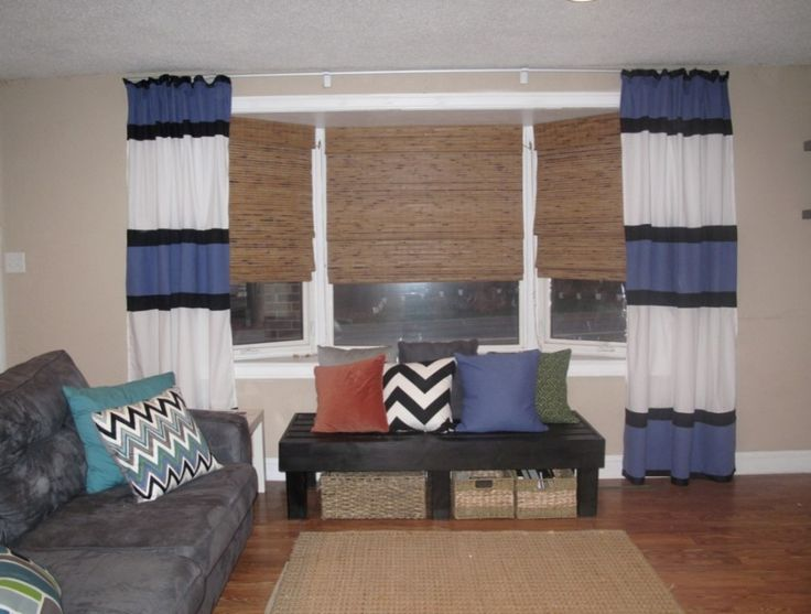 Endearing Shades And Blinds For Bay Window Decoration And Home Interior Ideas: Gorgeous Window Decoration With Wooden Blind For Bay Window Including Blue Stripe Curtain And Grey Tufted Velvet Sofa ~ groliehome.com Interior Inspiration