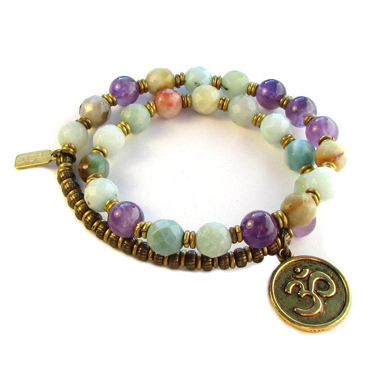 27 bead mala bracelet, made with genuine multi tone amazonite, and amethyst, hand made brass African Trade Beads (for sizing) and an Om charm. It wraps as a bracelet, (stringed on thick hi-tec elastic